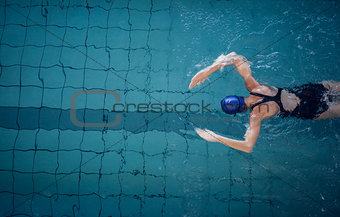 Fit woman swimming in the pool