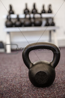 Black kettlebell on the weights room floor