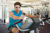 Focused man on the exercise bike