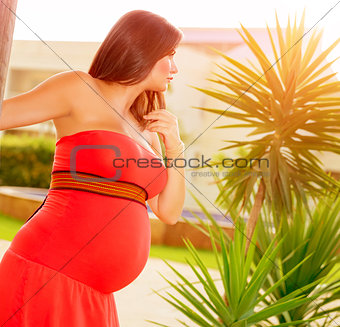 Pregnant girl on backyard
