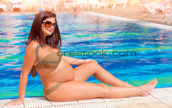 Pregnant woman near the pool