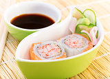 Tasty sushi with soy sauce