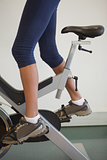 Fit woman on the spin bike