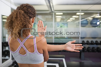 Fit woman stretching her arms