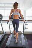 Fit woman walking on the treadmill