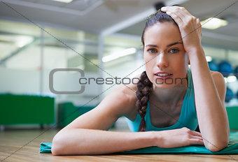 Fit tired brunette lying on studio floor
