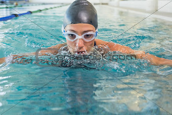 Fit swimmer coming up for air in the swimming pool
