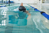 Fit swimmer doing the front stroke in the swimming pool