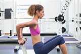 Fit woman exercising using the bench