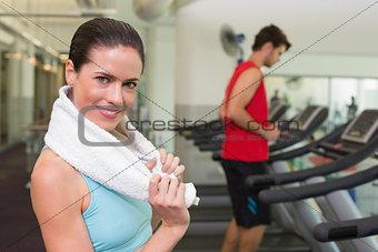 Smiling brunette with towel over shoulders