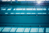 Large swimming pool with sunlight streaming in