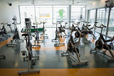 Large empty fitness studio with spin bikes