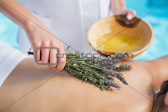 Woman getting an aromatherapy treatment poolside