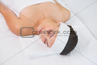 Peaceful brunette lying on massage table