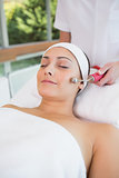 Peaceful brunette getting micro dermabrasion