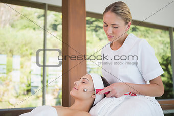 Smiling brunette getting micro dermabrasion