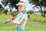 Female golfer smiling at camera