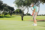 Female golfer putting her ball