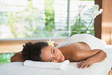 Gorgeous woman lying on massage table with salt treatment on back