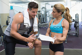 Bodybuilder talking with his personal trainer
