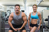 Bodybuilding man and woman posing for the camera