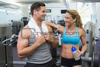 Bodybuilding man and woman chatting together