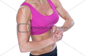 Female bodybuilder flexing mid section