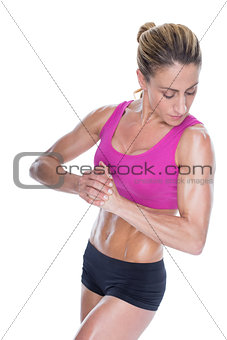 Female bodybuilder flexing with hands together