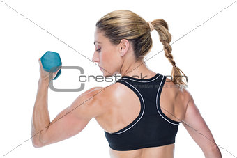 Female bodybuilder holding a dumbbell