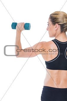 Female bodybuilder holding a blue dumbbell