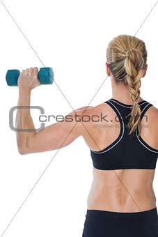Female bodybuilder holding a blue dumbbell