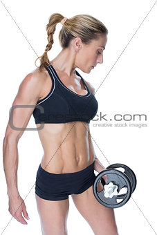 Female blonde bodybuilder holding large black dumbbell