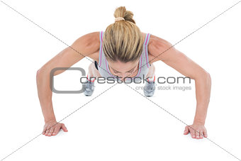 Strong woman doing press ups