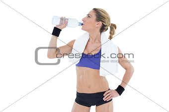 Strong blonde drinking from water bottle