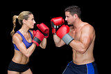 Bodybuilding couple posing with boxing gloves