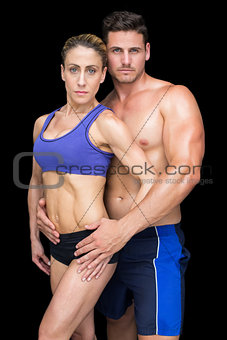 Fit bodybuilding couple posing together