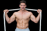 Tough crossfitter posing with rope around neck