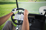 Golfer driving his golf buggy forward