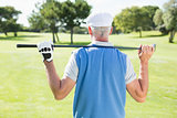 Golfer holding his club behind his head
