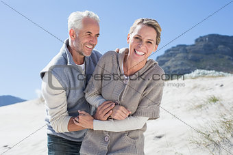 Attractive couple messing about on the beach