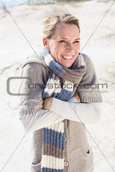 Attractive shivering blonde standing on the beach