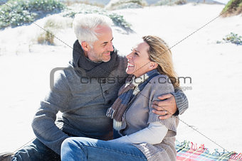 Carefree couple having picnic on the beach