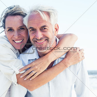 Attractive married couple posing at the beach