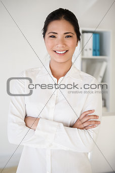 Casual asian businesswoman smiling at camera