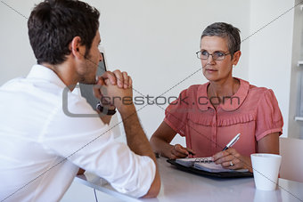 Casual businesswoman talking with colleague