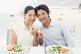 Happy asian couple having meal together