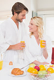 Couple having breakfast in their bathrobes