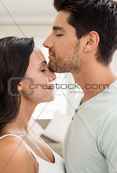 Attractive couple standing and hugging