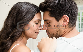 Attractive couple sitting face to face
