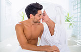 Attractive couple kissing in towels